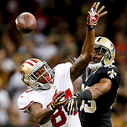 Nov 17, 2013; New Orleans, LA, USA; New Orleans Saints cornerback Jabari Greer (33) breaks up a pass to San Francisco 49ers wide receiver Jon Baldwin (84) during the first quarter of a game at Mercedes-Benz Superdome.  Jabari Greer sustained a let injury on the play as was carted off the field. Mandatory Credit: Derick E. Hingle-USA TODAY Sports