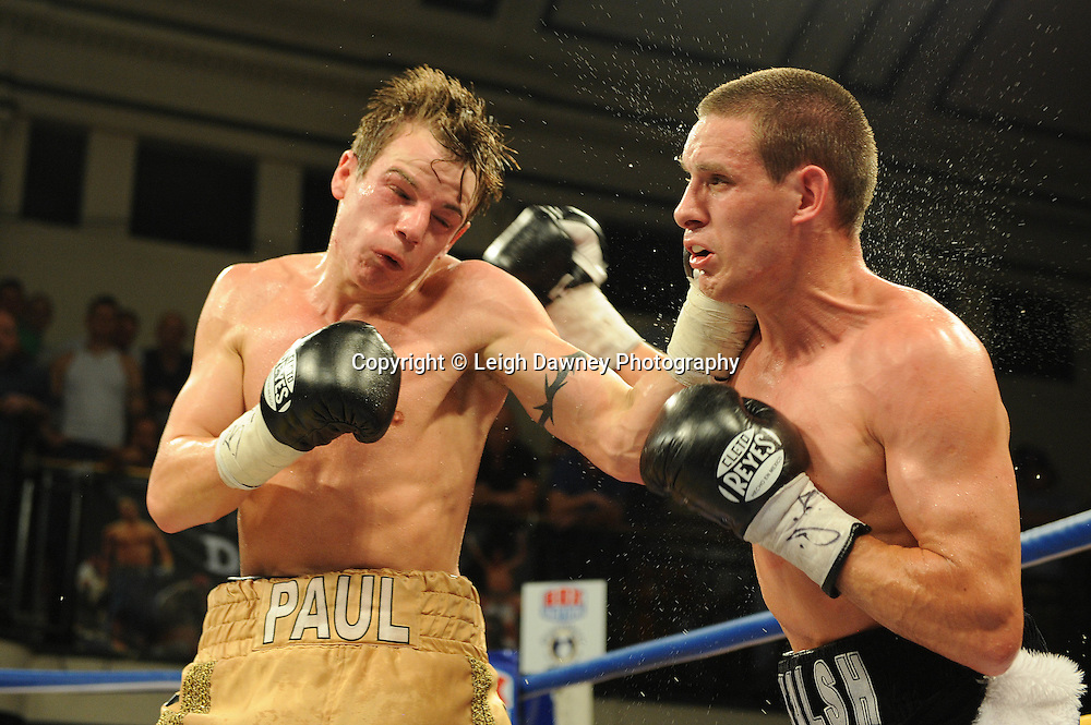 Liam Walsh (black/white shorts) defeats Paul Appleby for The Commonwealth Super-Featherweight Championship at York Hall, Bethnal Green, London on Friday 30th September 2011. Box Nation.tv's debut live TV Channel 456 on Sky. Photo credit: © Leigh Dawney. Queensberry Promotions.