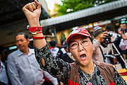 28 APRIL 2014 - BANGKOK, THAILAND: Mourners cry out during the funeral for Kamol Duangphasuk, 45, in Bangkok. Kamol was a popular poet who wrote under the pen name Mai Nueng Kor Kunthee. Kamol had been writing since the 1980s and was an outspoken critic of the 2006 coup that deposed Thaksin Shinawatra. After the 2010 military crackdown against the Red Shirts he went into temporary self imposed exile fearing for his safety. After he returned to Thailand he organized weekly protests against Thailand's Lese Majeste laws, which he said were being used to stifle dissent. Kamol was shot and murdered on April 23. The assailants are still at large but the murder is thought to be political.     PHOTO BY JACK KURTZ
