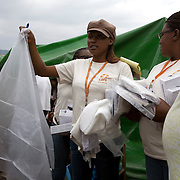 Jina Guillet, 27, a nurse with CARE works with the health team to distribute delivery kits to pregnant women in Delmas 31 camp. The delivery kits include plastic sheeting, gloves, razor, and gauze, to help women deliver more safely in emergency situations.