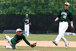 28 April 2012:  Anthony Lopez dives to catch an infield hit during an NCAA division 3 Baseball game between the Augustana Vikings and the Illinois Wesleyan Titans in Jack Horenberger Stadium, Bloomington IL