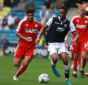Chesterfield player Sam Morsy goes shoulder to shoulder with Millwall player Shaun Cummings during the Sky Bet League 1 match between Millwall and Chesterfield at The Den, London, England on 29 August 2015. Photo by Bennett Dean.