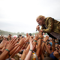 Vocalist Christian Zucconi of the band Grouplove greets fans during a performance at the Firefly Music Festival in Dover, DE on June 21, 2014.  The four day festival is set at a 105 acre grounds at the Dover International Speedway and many well known bands perform.