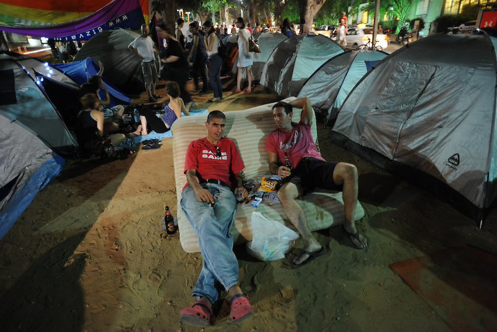 TEL AVIV, ISRAEL - JULY 19, 2011: Israelis sit amid dozens of tents pitched in the center of Tel Aviv on July 19, 2011, in protest against the rising prices of real estate in Israel.