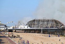 © Licensed to London News Pictures. 30/07/2014. Eastbourne, UK. A fire has broken out on Eastbourne Pier this afternoon, 30th July 2014. Firefighters, police, coastguards and lifeboat crews are at the scene after a fire was discovered in a wall panel of an arcade at the front of the Victorian structure. Photo credit : Hugo Michiels/LNP