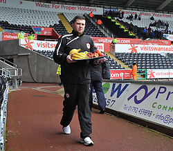 one of the cardiff city staff comes into the liberty stadium with a tray of fruit.  - Photo mandatory by-line: Alex James/JMP - Tel: Mobile: 07966 386802 08/02/2014 - SPORT - FOOTBALL - Swansea - Liberty Stadium - Swansea City v Cardiff City - Barclays Premier League