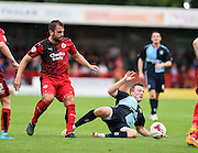 Simon Walton is tackled by Wycombe's Garry Thompson during the Sky Bet League 2 match between Crawley Town and Wycombe Wanderers at the Checkatrade.com Stadium, Crawley, England on 29 August 2015. Photo by David Charbit.