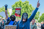 The protest moved down Whitehall and briefly stopped outside Downing Street led by a small group of masked activists - A day after the election result protestors gather to ask for Theresa May to quit and not do a deal with the DUP. Who people fear because of their views on abrtion, gay marriage etc. Westminster, London, 10 Jun 2017