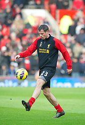 MANCHESTER, ENGLAND - Sunday, January 13, 2013: Liverpool's Jamie Carragher warms-up before the Premiership match against Manchester United at Old Trafford. (Pic by David Rawcliffe/Propaganda)