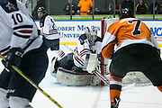 Robert Morris goaltender Terry Shafer makes a save during the Atlantic Hockey final against RIT at the Blue Cross Arena in Rochester on Saturday, March 19, 2016.