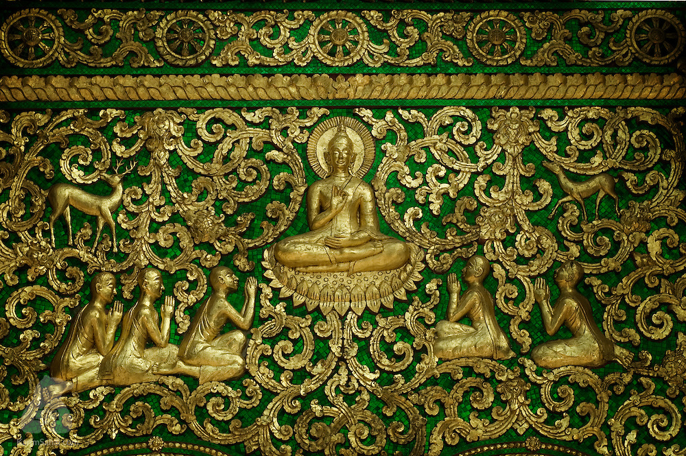 A gold painted wood carving adorns the door of Wat Xieng Thong temple in Luang Prabang, Laos. The 16th century temple the received World Heritage status in 1995, by the UNESCO.