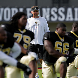 31 July 2009: Saints head coach Sean Payton walks among players as they stretch prior to the morning session practice during the opening day of New Orleans Saints training camp held at the team's practice facility in Metairie, Louisiana.