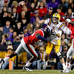 November 17, 2012; Baton Rouge, LA, USA; Ole Miss Rebels defensive end Cameron Whigham (55) hits LSU Tigers quarterback Zach Mettenberger (8) as a throws during the fourth quarter of a game at Tiger Stadium. LSU defeated Ole Miss 41-35. Mandatory Credit: Derick E. Hingle-US PRESSWIRE