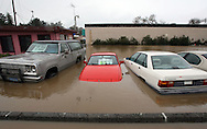 Submerged cars sit at a flooded parking lot in Petaluma, Calif. during heavy rain storms in Northern California on Saturday Dec. 31, 2005. (AP Photo/Jakub Mosur)