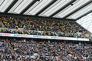Picture by Paul Chesterton/Focus Images Ltd.  07904 640267.18/03/12.The traveling Norwich fans high up in the stands before the Barclays Premier League match at St James' Park Stadium, Newcastle.