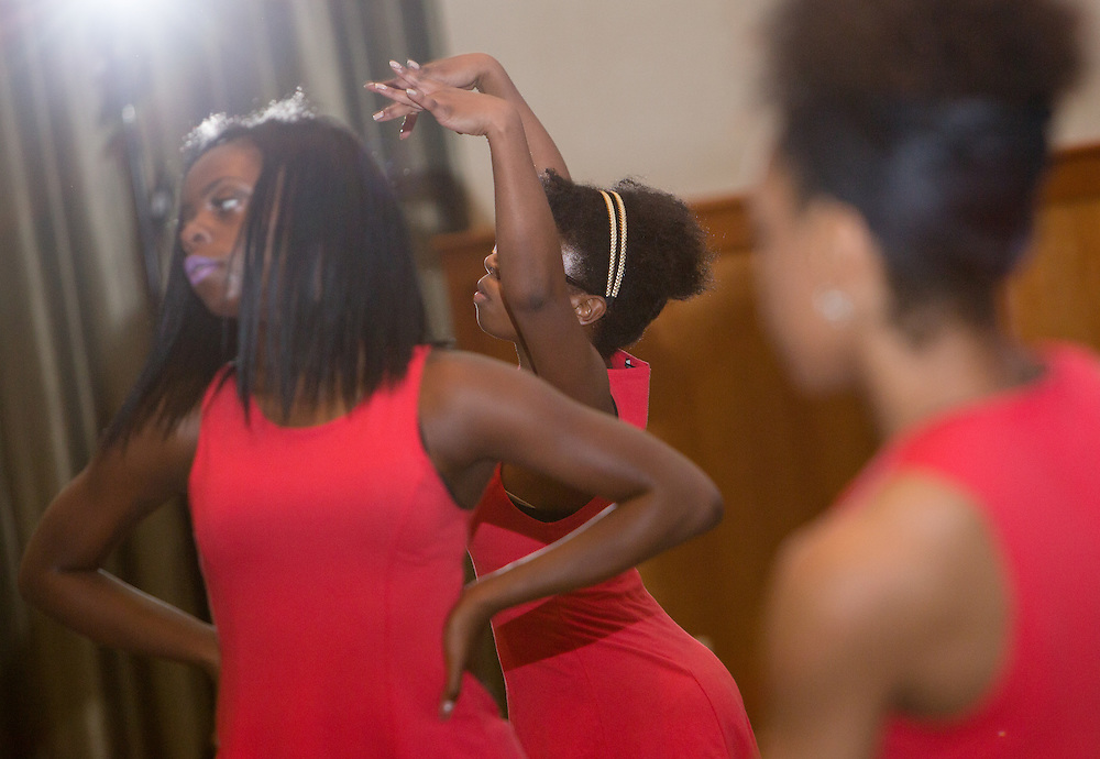 From left: ABCD dancers Brittany Spivey, Michaela Bateman, and Najah Braswell give a performance during the first-ever Men of Black Excellence Awards at Ohio Univesity, held on April 13, 2014, in Walter Rotunda. The ceremony recognized African American students in categories such as academics, campus involvement, and the performing arts, among others, and featured keynote speaker Aaron Jeter. Photo by Lauren Pond
