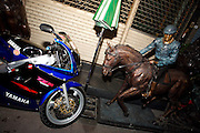 Silom Road. Horse rider monument and motorbike.