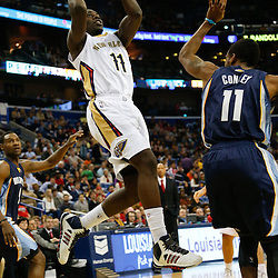 Dec 13, 2013; New Orleans, LA, USA; New Orleans Pelicans point guard Jrue Holiday (11) shoots over Memphis Grizzlies point guard Mike Conley (11) during the second quarter of a game at New Orleans Arena. Mandatory Credit: Derick E. Hingle-USA TODAY Sports