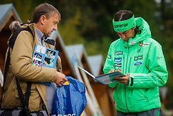 Primoz Peterk autographing fans book during national competition in Ski Jumping, 8th of October, 2016, Kranj,  Slovenia. Photo by Grega Valancic / Sportida