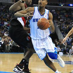 02 February 2009:  New Orleans Hornets center Hilton Armstrong (12) drives past Portland Trailblazers center Greg Oden (52) during a 97-89 loss by the New Orleans Hornets to the Portland Trail Blazers at the New Orleans Arena in New Orleans, LA.