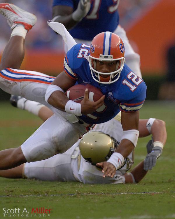 Sept. 9, 2006; Gainesville, FL, USA; Florida Gators quarterback Chris Leak is tackled by Central Florida Golden Knights defender Kyle Fowler in the first half at Ben Hill Griffin Stadium. ...©2006 Scott A. Miller