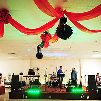 "013114  Adron Gardner/Independent<br /> <br /> The Band Extended Warranty fires up the stage lights before the ""Paint the Town Red: Ladies Night Out"" fundraiser at the Knights of Columbus Hall for in Grants Friday."
