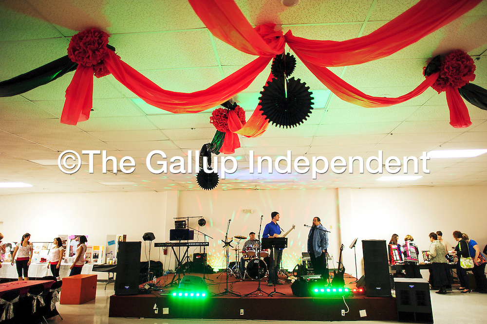 """013114  Adron Gardner/Independent<br /> <br /> The Band Extended Warranty fires up the stage lights before the """"Paint the Town Red: Ladies Night Out"""" fundraiser at the Knights of Columbus Hall for in Grants Friday."""