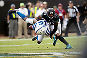 Indianapolis Colts wide receiver Dontrelle Inman (15) goes airborne while trying to catch a first quarter pass broken up by Jacksonville Jaguars cornerback A.J. Bouye (21) during the NFL week 13 regular season football game against the Jacksonville Jaguars on Sunday, Dec. 2, 2018 in Jacksonville, Fla. The Jaguars won the game in a 6-0 shutout. (©Paul Anthony Spinelli)