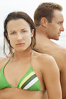 Woman and Boyfriend Sitting Back to Back on Beach