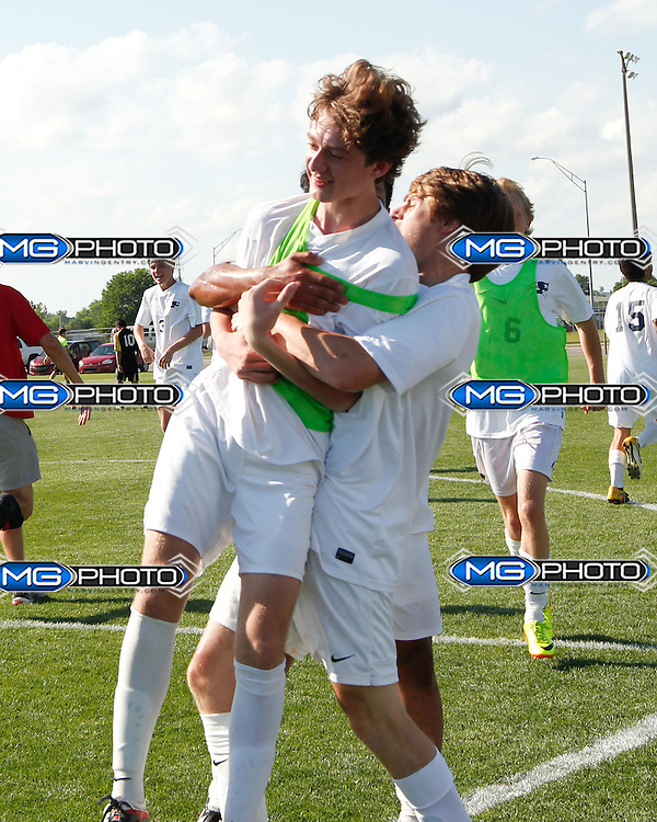 May 10, 2014; Huntsville, AL, USA;  Homewood Teammates celebrate after winning  the 5A Boys State Soccer Championship at John Hunt Soccer Complex. Mandatory Credit: Marvin Gentry