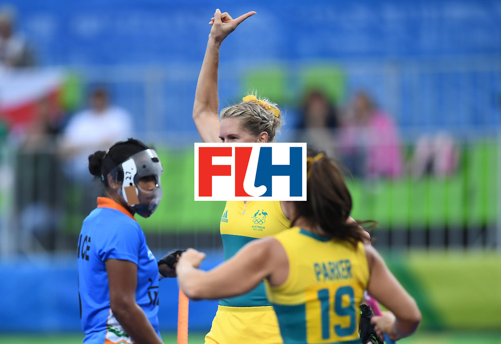 Australia's Jodie Kenny (C) celebrates scoring a goal during the women's field hockey India vs Australia match of the Rio 2016 Olympics Games at the Olympic Hockey Centre in Rio de Janeiro on August, 10 2016. / AFP / MANAN VATSYAYANA        (Photo credit should read MANAN VATSYAYANA/AFP/Getty Images)