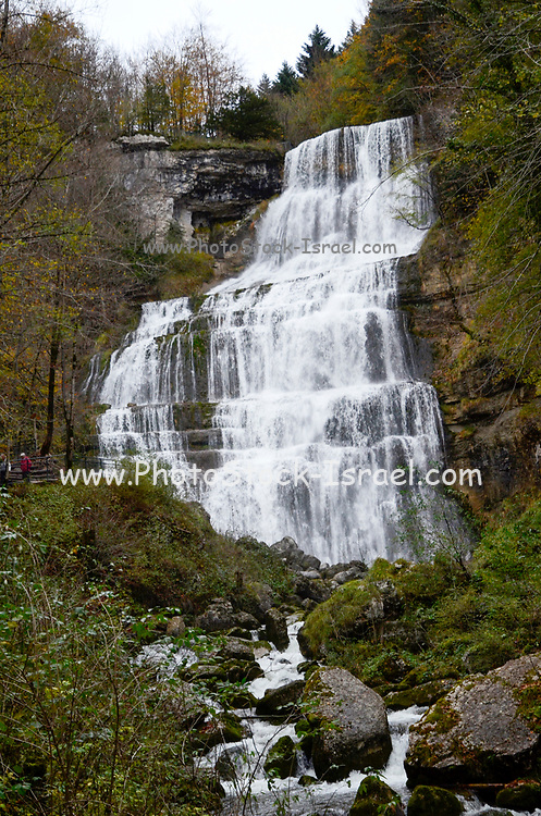 Cascading waterfall flowing from the mountain top