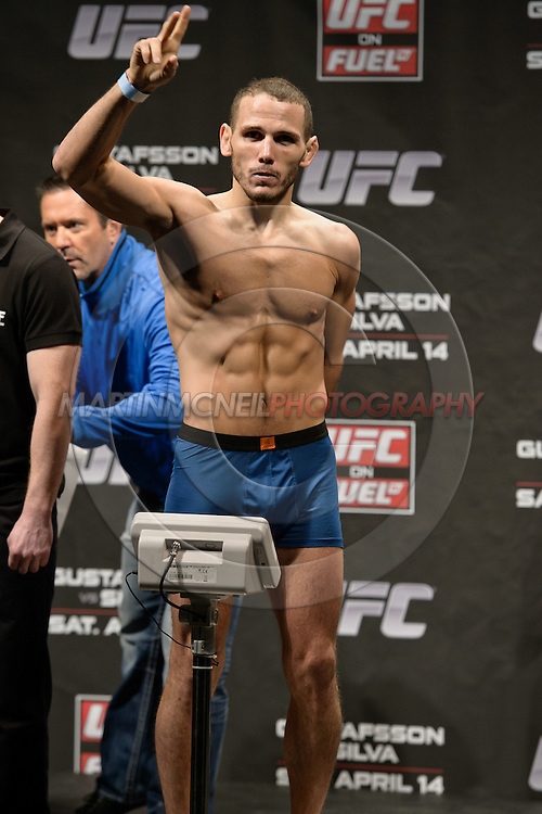 "STOCKHOLM, SWEDEN, APRIL 13, 2012: Eric Wisely stands on the scales during the weigh-in for ""UFC on Fuel TV: Gustafsson vs. Silva"" inside the Ericsson Globe Arena, Stockholm."