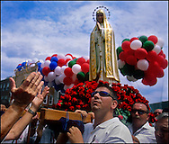 GLOUCESTER, MA- JUNE 29, 2003:  Fishermen carry the statue of the Virgin Mary through the streets during the annual celebration paying homage to St. Peter, the patron saint of fishermen in Gloucester, MA. The festa takes place on the weekend closest to the Feast Day of St. Peter, June 29. .(Photo by Robert Falcetti) . .