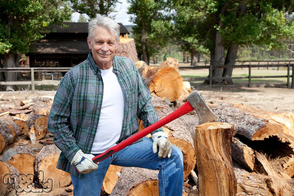 Portrait of senior lumber jack holding an axe