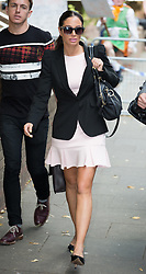 Image ©Licensed to i-Images Picture Agency. 17/07/2014. London, United Kingdom. Tulisa Contostavlos leaves Southwark Crown Court, London. Picture by Daniel Leal-Olivas / i-Images
