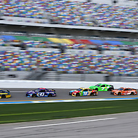 David Ragan (38), Darrell Wallace Jr. (43), Kyle Busch (18), Danica Patrick (7), Daniel Suarez (19) and Ricky Stenhouse Jr. (17) are seen on the front stretch during practice for the 60th Annual NASCAR Daytona 500 auto race at Daytona International Speedway on Friday, February 16, 2018 in Daytona Beach, Florida.  (Alex Menendez via AP)