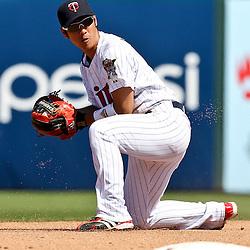 March 11, 2011; Fort Myers, FL, USA; Minnesota Twins second baseman Tsuyoshi Nishioka (1) during a spring training exhibition game against the Boston Red Sox at Hammond Stadium.   Mandatory Credit: Derick E. Hingle
