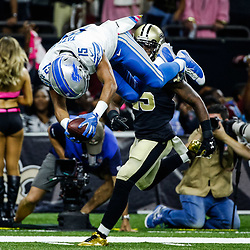 Oct 15, 2017; New Orleans, LA, USA; Detroit Lions wide receiver Golden Tate (15) flips into the endzone for a touchdown past New Orleans Saints defensive back Rafael Bush (25) during the first quarter of a game at the Mercedes-Benz Superdome. Mandatory Credit: Derick E. Hingle-USA TODAY Sports