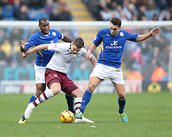 Burnley's Sam Vokes is challenged by Leicester City's Matthew James and Leicester City's Wes Morgan - Photo mandatory by-line: Nigel Pitts-Drake/JMP - Tel: Mobile: 07966 386802 14/12/2013 - SPORT - Football - Leicester - King Power Stadium - Leicester City v Burnley - Sky Bet Championship