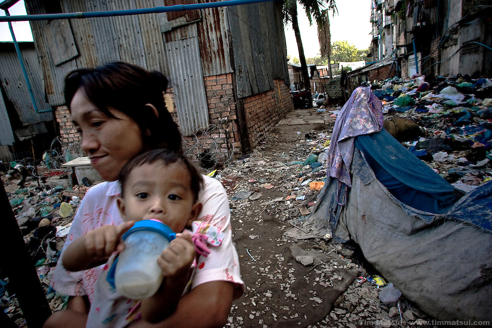 Prostitute Wue at home in a Phnom Penh slum known for gangs, pimps, prostitutes, and high rate of HIV.