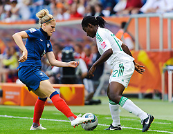 26.06.2011, Rhein-Neckar-Arena, Sinsheim, GER, FIFA Women's Worldcup 2011, GRUPPE A, NIGERIA (NGA) vs FRANKREICH (FRA) , im Bild Laure LEPAILLEUR (FRA #11, Paris St-Germain) im Zweikampf mit Glory IROKA (NGA #11,Rivers Angels)   // during the FIFA Women's Worldcup 2011, Pool A, Nigeria (NGA) vs France (FRA) on 2011/06/26, Rhein-Neckar-Arena, Sinsheim, Germany. EXPA Pictures © 2011, PhotoCredit: EXPA/ nph/  Roth       ****** out of GER / SWE / CRO  / BEL ******