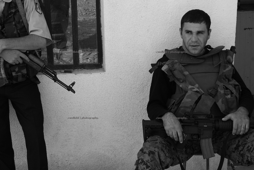 Armed georgian policemen at a checkpoint in Ergneti, located in the so called bufferzone between Gori and Tskhinvali, few days after the withdrawal of the russian forces from the area. The bufferzone was etablished after a short war in August 2008 as the georgian army assulted South Ossetia to overthrow the local separatist government.