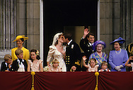 Prince Andrew and Sarah Ferguson, Duchess of York, kiss on the balcony of Buckingham Palace after their wedding...Photograph by Dennis Brack bb 27