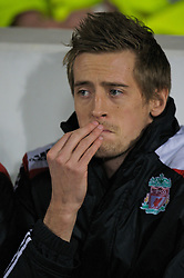 LONDON, ENGLAND - Wednesday, January 30, 2008: Liverpool's Peter Crouch sits on the bench as an unused substitute against West Ham United during the Premiership match at Upton Park. (Photo by David Rawcliffe/Propaganda)