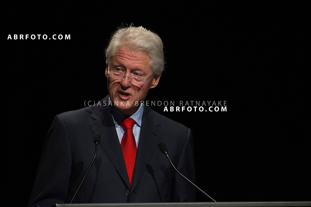 Former US President Bill Clinton speaking during his speech which was earlier disrupted by about 20 protestors belonging to the Robin Hood Tax coalition during a session of the 20th International AIDS conference held in Melbourne Australia. The former American President also paid tribute to the victims of Malaysian Airlines MH17 - Asanka Brendon Ratnayake