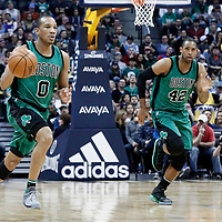 10 March 2017: Boston Celtics guard Avery Bradley (0) brings the ball up court next to Boston Celtics center Al Horford (42) during the Denver Nuggets 119-99 victory over the Boston Celtics, at the Pepsi Center, Denver, Colorado, USA.