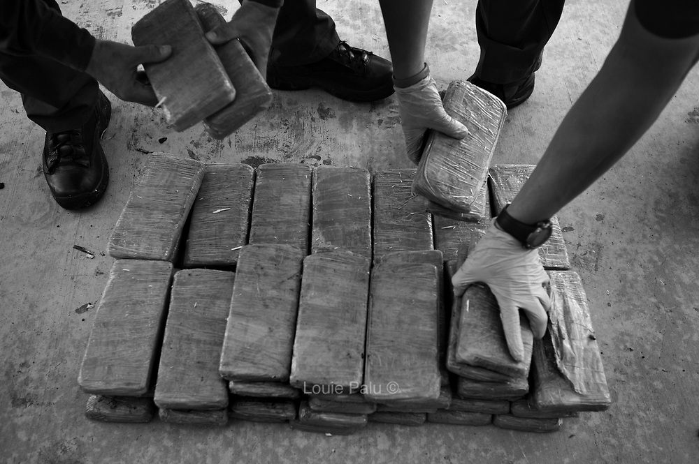 U.S. Border Patrol Agents stack bundles of marijuana seized from a vehicle at a checkpoint on the I-35 highway just north of the key port of entry from Mexico located in Laredo, Texas..(Credit Image: © Louie Palu/ZUMA Press)