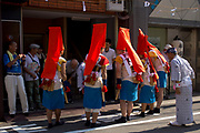 Well wishing a business at the Tenjin Festival (Tenjin Matsuri) in Osaka.