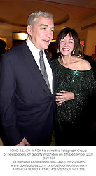 LORD & LADY BLACK he owns the Telegraph Group of newspapers, at a party in London on 4th December 2001.OUY 107